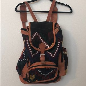 Leather, embroidered backpack
